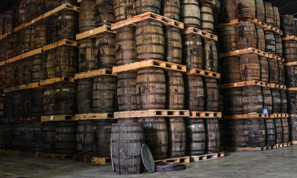 THE LIQUORS INTO THE SEARCH OF FLAVORS AND COLORS Photo. Rum in old bourbon barrels